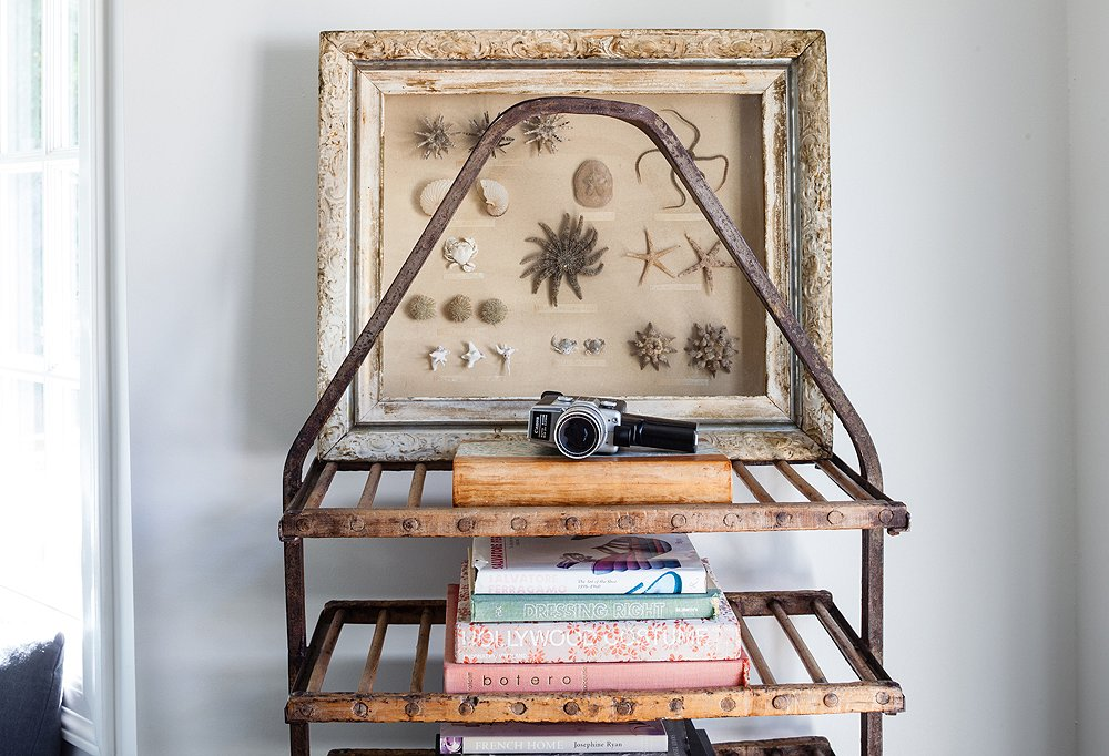 The couple turned the utilitarian need of bedroom storage into a stunning vignette with the help of a vintage baker's rack and a few prized possessions.