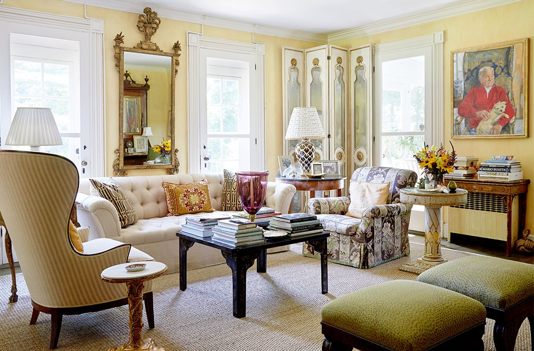 The living room sparkles with gold accents plus art and objects that reflect the couple's interest in animals and gardens.