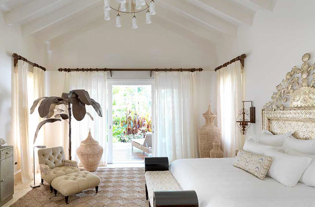 Natural textures and chic finishing touches in an airy bedroom by Celerie epitomize her relaxed, glamorous style.