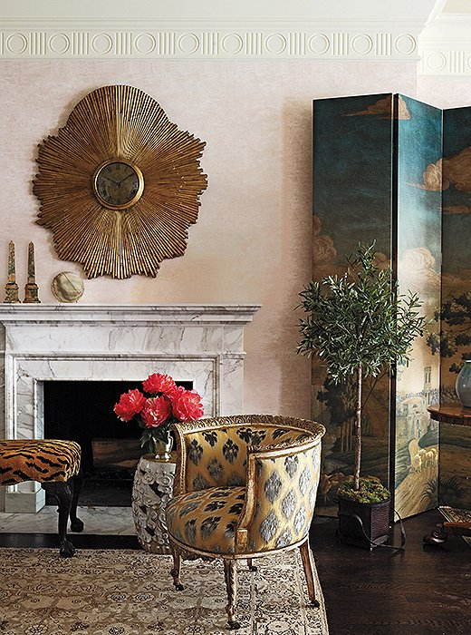 Luxe materials, such as marble, brass, and luscious fabrics, are hallmarks of Celerie's richly layered interiors.