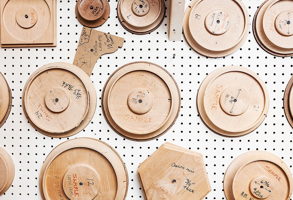 A wall in the studio shows base styles for Spitzmiller's lamps.