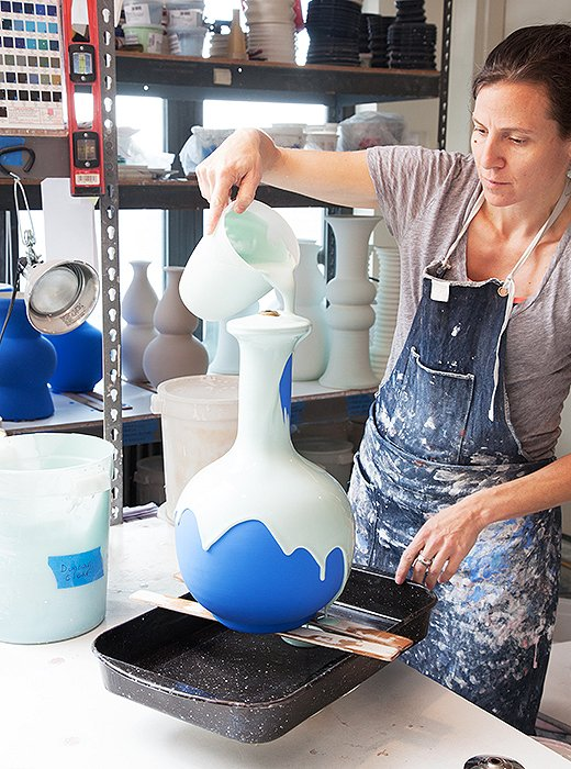 After the shapes are bisque-fired, each lamp gets several coats of glaze to produce a rich color.