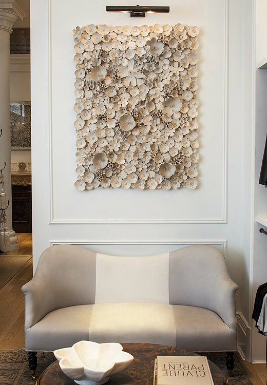 A seating area under a stunning contemporary art piece seduces customers into lingering.