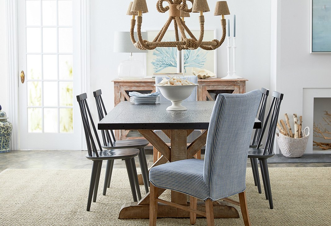 Wrapped in jute, this chandelier accentuates a coastal vibe when complementing blue-striped chairs (the Shannon side chair is similar to those above). Even without the nautical stripes, the fixture brings organic elegance to  a space.
