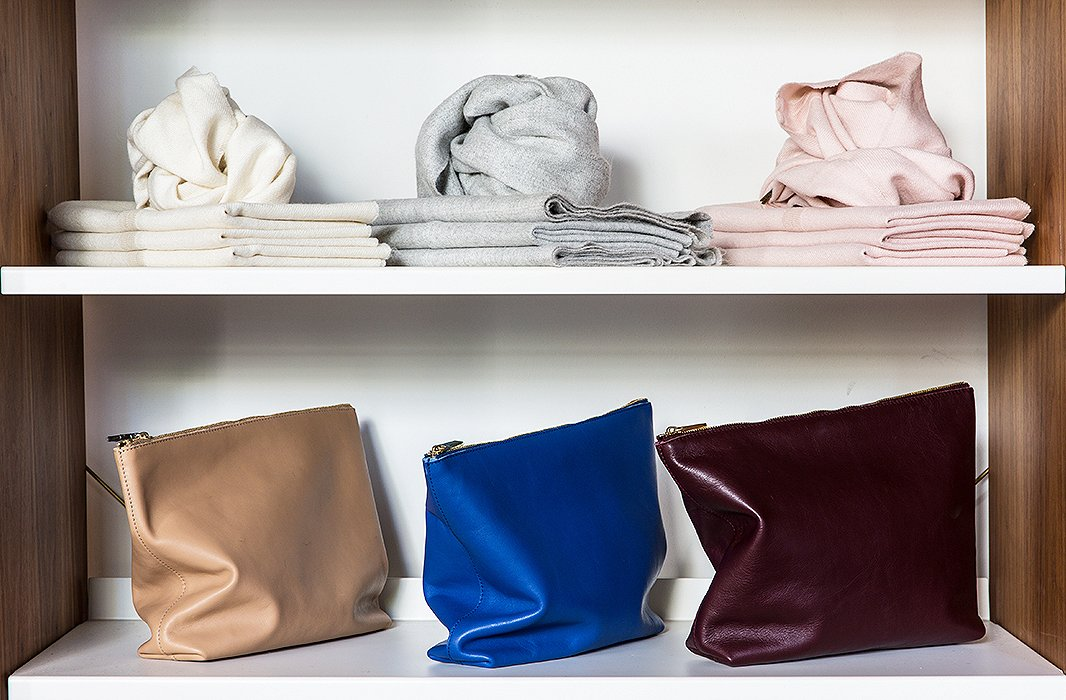 Covetable alpaca scarfs are displayed alongside colorful leather pouches, which happen to be the perfect fold-over clutches.