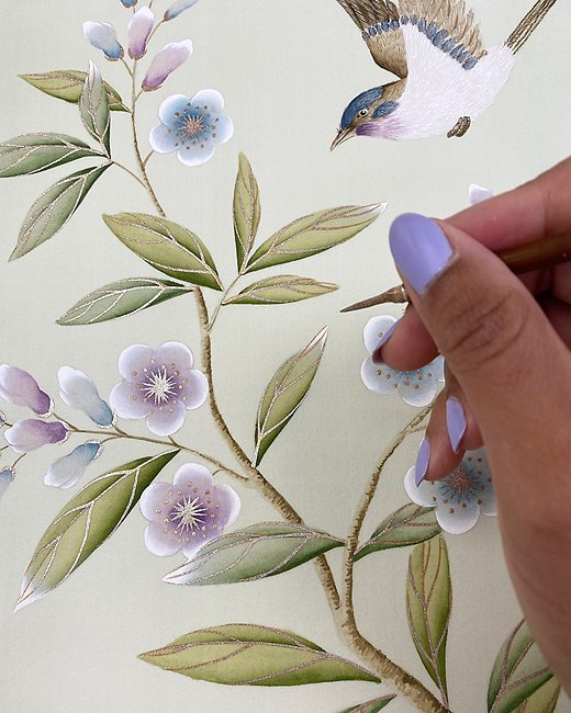 Chinoiserie really shines in the detail work. Diane uses a variety of brushes to highlight certain parts of the design. Here, she is using a small brush tip to add gold accents to the flowers and leaves.