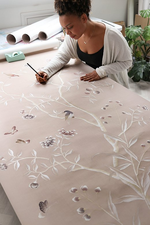 Diane in her studio painting a wallpaper panel. Each panel takes her one week from start to finish.