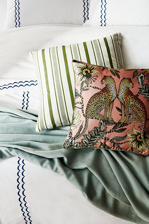 Green embroidery on the linens would have been the obvious choice to tie in with the other green elements—but since when do Eclectics opt for the obvious? Shown above:Rosemary Sheet Set in Hamptons Blue, Cashmere Throw in Spa Green, Finn Stripe Pillow in Moss/White, and Leopard Silk Pillow in Magnolia.