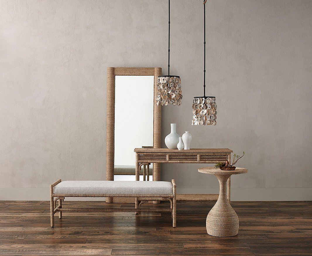 Furnishings from Currey & Company including the Vilmar Rope Mirror, the Olisa Rope Console Table, and the Simo Rope Accent Table show how abaca rope can add a tropical note to classic designs.