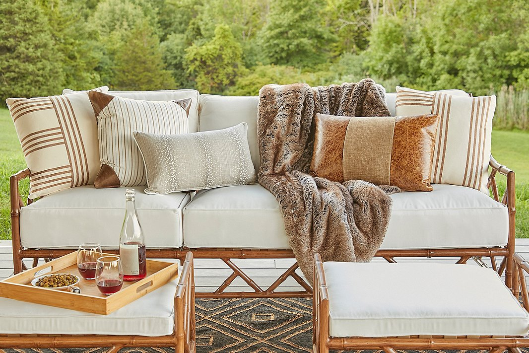 Faux-fur throws,leather pillows, and animal prints show how luxurious natural influences can be.Items shown above include the Further pillow (far left and far right), the Evie lumbar pillow(center), the Mia Faux-Fur Throw in timber wolf, and on top of the throw, the Abby lumbar pillow.