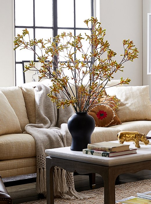 Styled on their own, long-stemmed kangaroo pod branches make a simple statement.