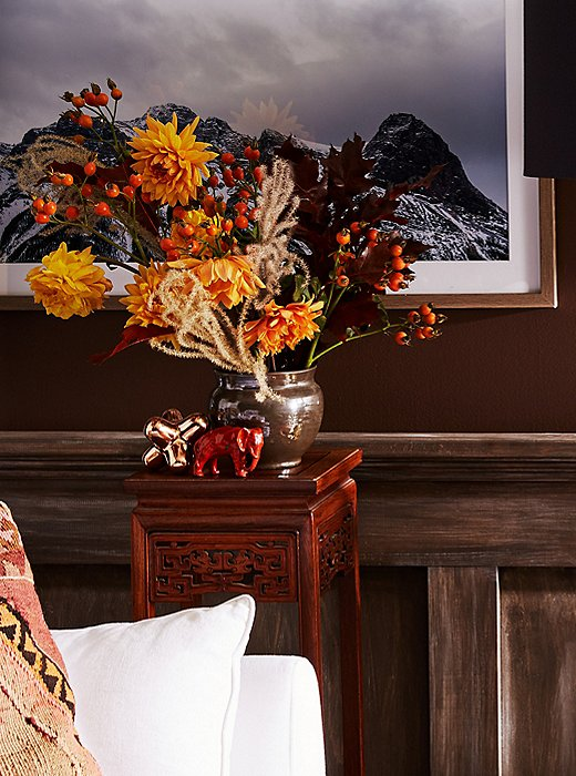 Golden dahlias, crabapple branches, black oak leaves, and dried feathery grass create a wildly beautiful bouquet.
