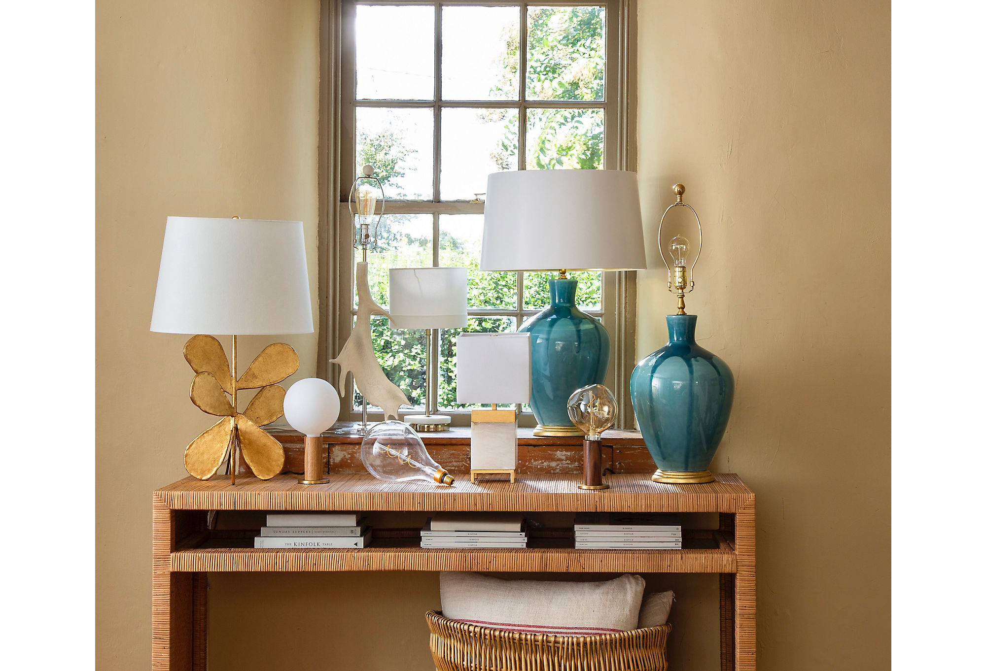 Table lamps are among the most versatile light fixtures out there. Think of them as objets or pieces of art. Lamps shown on the table above, from left: Jane Petal Table Lamp, Knuckle Matte Table Lamp in Oak/Brass, Jillian Table Lamp, Knuckle Clear Table Lamp in Walnut/Brass, and Gisele Drip Table Lamp.