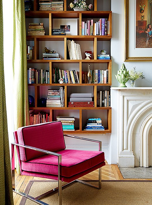 "A set of '70s Milo Baughman armchairs lend extra seating. ""I am a child of the disco era,"" says Fawn. ""And I really love pink and green even though it's a traditionally preppy color pairing."""