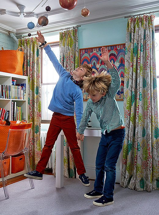 "Fawn's sons, Gaspar and Laszlo, jump for joy in their shared bedroom. ""I always tell my clients, Use timeless things that children love—animal motifs, colorful prints,"" she says. ""I don't like spaces that are too 'kiddy.'"""