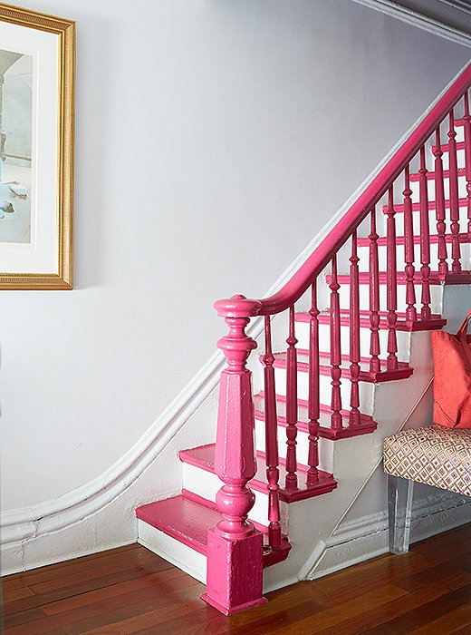 "Fawn used a bit of ""smoke and mirrors"" to disguise a battered banister. Instead of a lengthy refinishing job, she painted it Benjamin Moore's Gypsy Pink. ""I wanted to distract from a certain unrefinement,"" says Fawn."