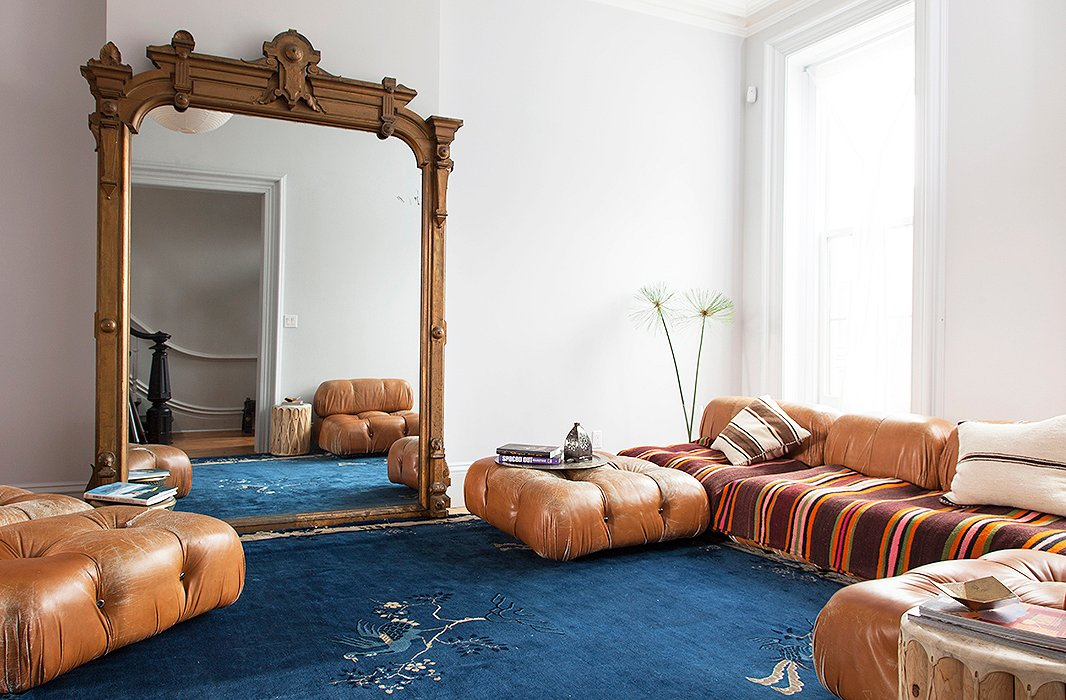 Designer Julia Chaplin completed her global-chic living room with an oversized floor mirror leaned casually against the wall.