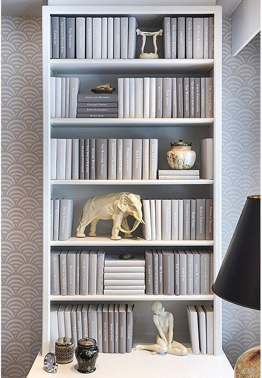Custom jackets in shades of gray give this bookshelf a modern, minimalist look.