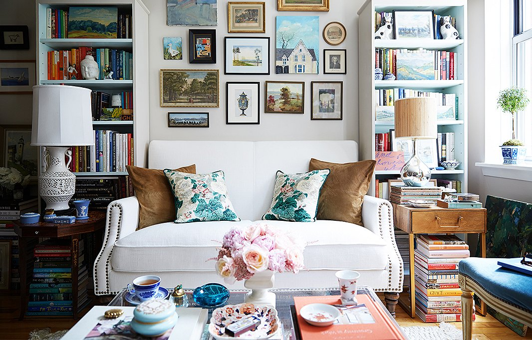 Flanking bookshelves create the perfect nook for the living room's petite settee.