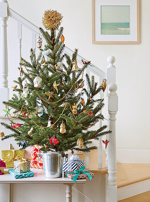 Instant mood-booster: Seeing a (trimmed) mini tree right as they come in tells guests they're in for a good time.