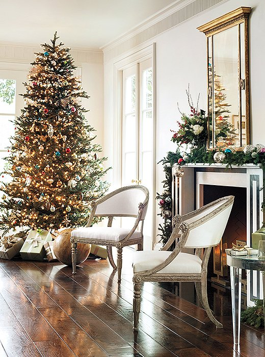 The organized chaos of a tree is the perfect combination of personal and public. Try a mix of ornaments to accentuate the look.