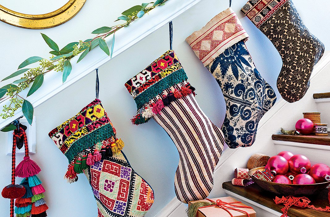 Why stop at the mantel? Hang stockings (exquisitely designed ones, of course) along your entry stairs too—pure fun.