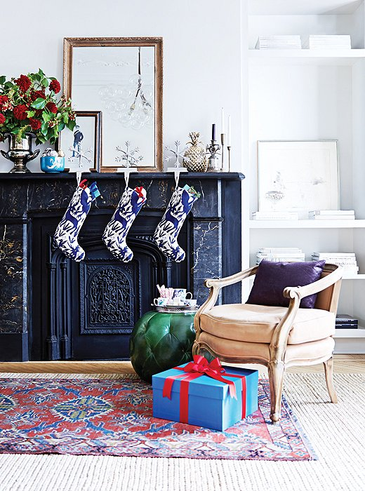 Small touches can go a long way to making your space feel festive. Stockings and holders added to your mantel embrace the season with style.