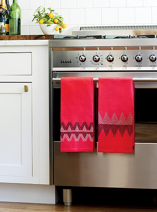 Nordic patterns on bright tea towels elevate (and holiday-ize) the whole space.