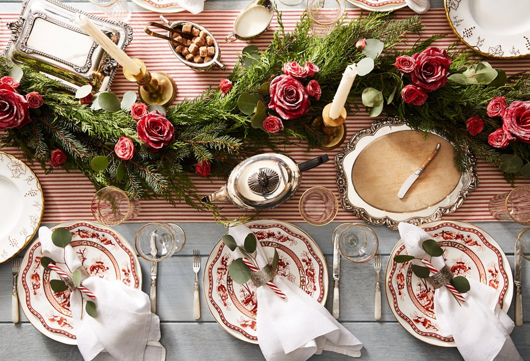 Classic holiday plates, timeless silver serveware, a stunning centerpiece of greenery and florals: This holiday look will always be in style.