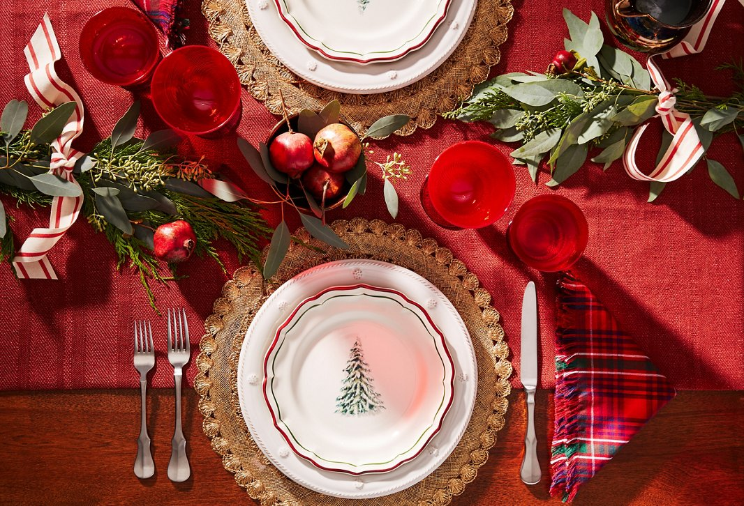 Mix and match everyday dinnerware (such as Juliska's Berry & Thread Dinner Plate shown here) with holiday designs (such as the plate from Gien's Noel collection and Juliska's Christmas Tartan Dinner Napkin, also shown here) for an elegant and balanced seasonal look.