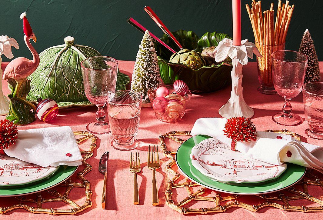 Give your table a preppy, poppy twist with a mix of green, pink, and red. Lettuceware, bottle-brush trees, and plates from Juliska's Country Estate holiday collection create a fabulously unexpected look.