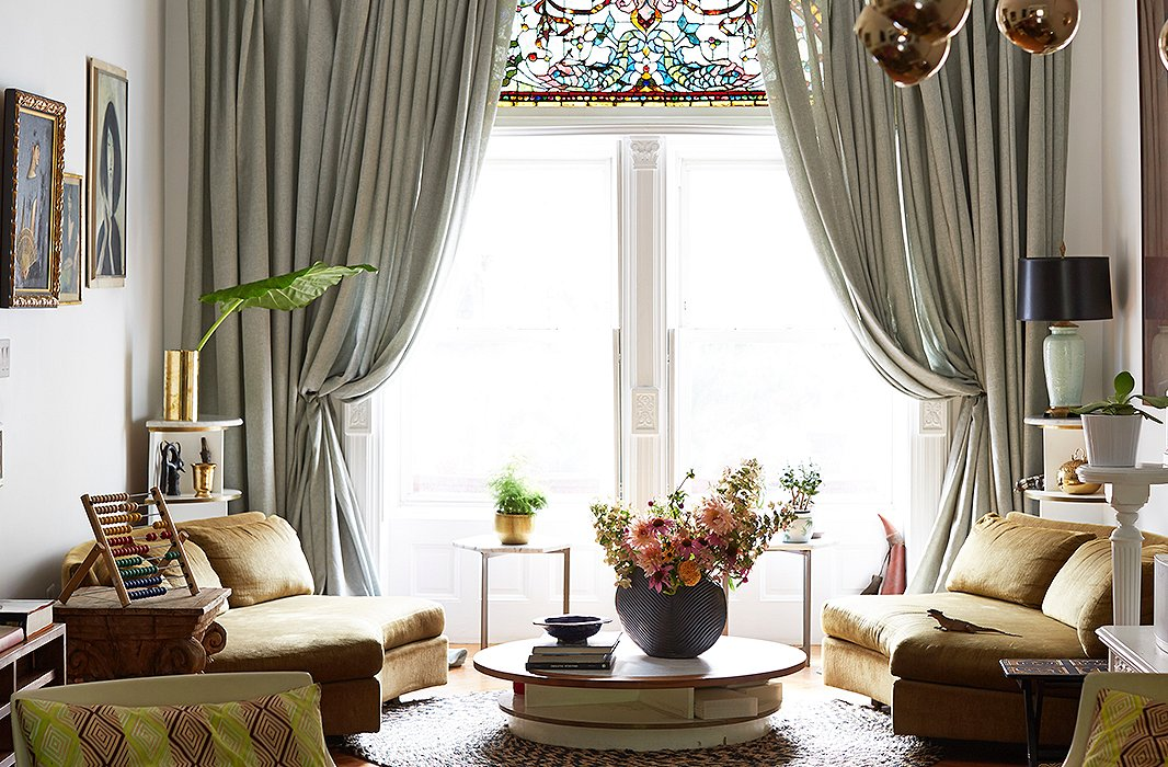 To frame the opalescent stained-glass window, Jodie put up dramatic curtains that pool generously on the floor.