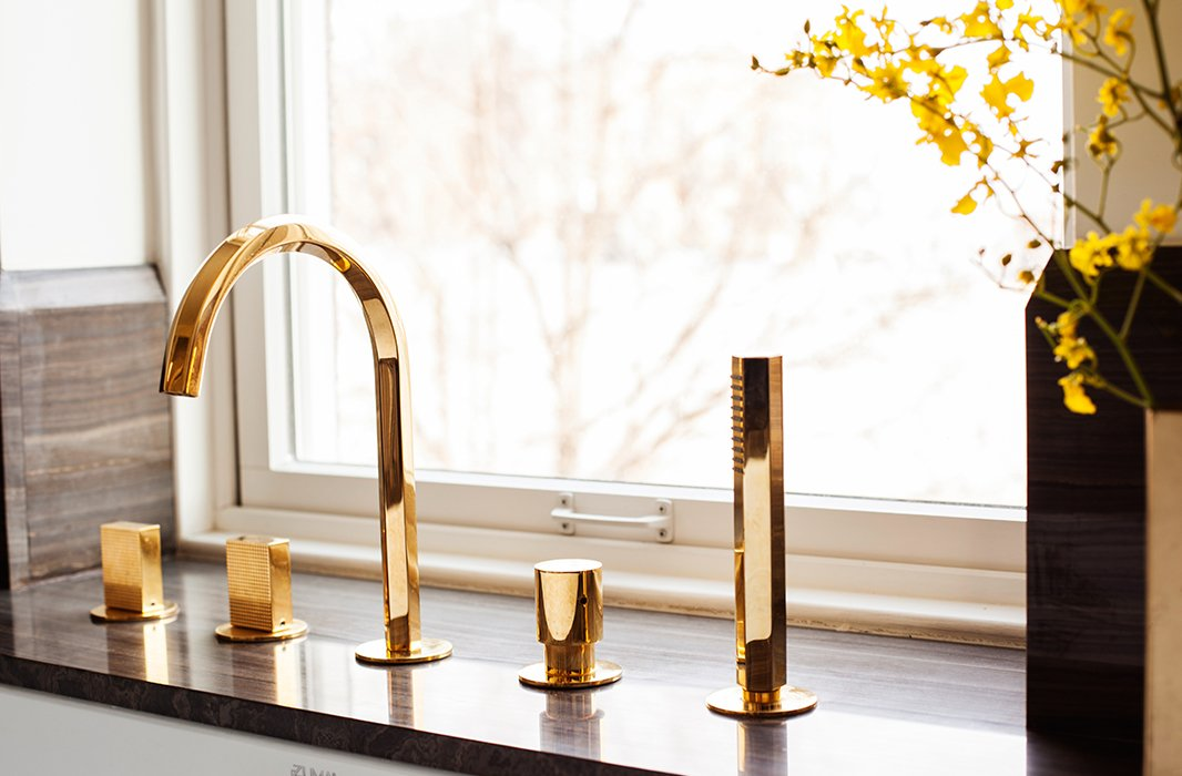 The insanely gorgeous gold-plated fixtures are from Fantini Rubinetti. Though they appear utterly contemporary, Julia says they remind her of 1980s New York City hot spot Mr. Chow.