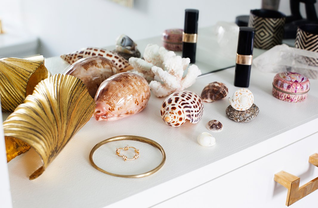 "In her bath, you can find Julia's shell collection, trinkets brought back from far-flung destinations like the Gili Islands, Tortola, and Bahia. ""They're not museum-quality, but I find the best I can find as souvenirs for myself."""