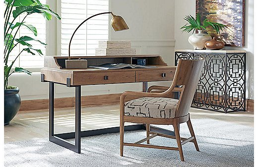 The oak top of the Kendelston Writing Desk sits on a simple metal frame given a warm bronze finish. Not only is oak durable, but it's also resistant to scratches and even dust!