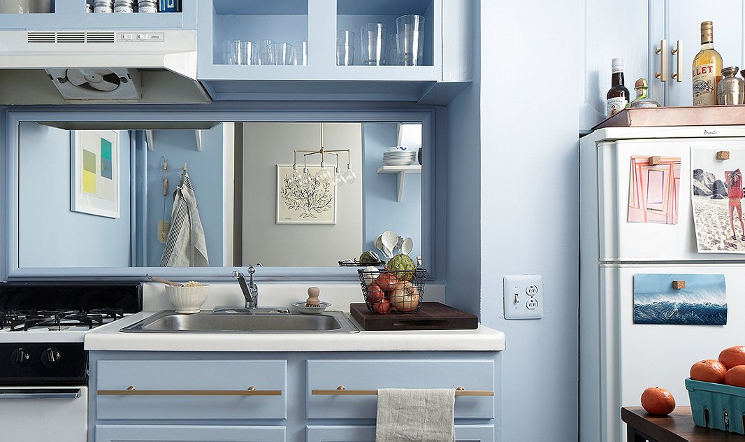 If your kitchen lacks a window, a mirror over the sink lets you watch the proceedings going on behind you while you wash up in addition to reflecting light.