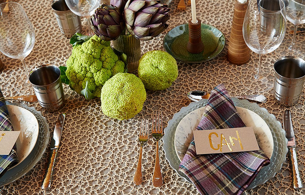 Osage oranges and green cauliflower add an unexpected pop of lime green to the table.