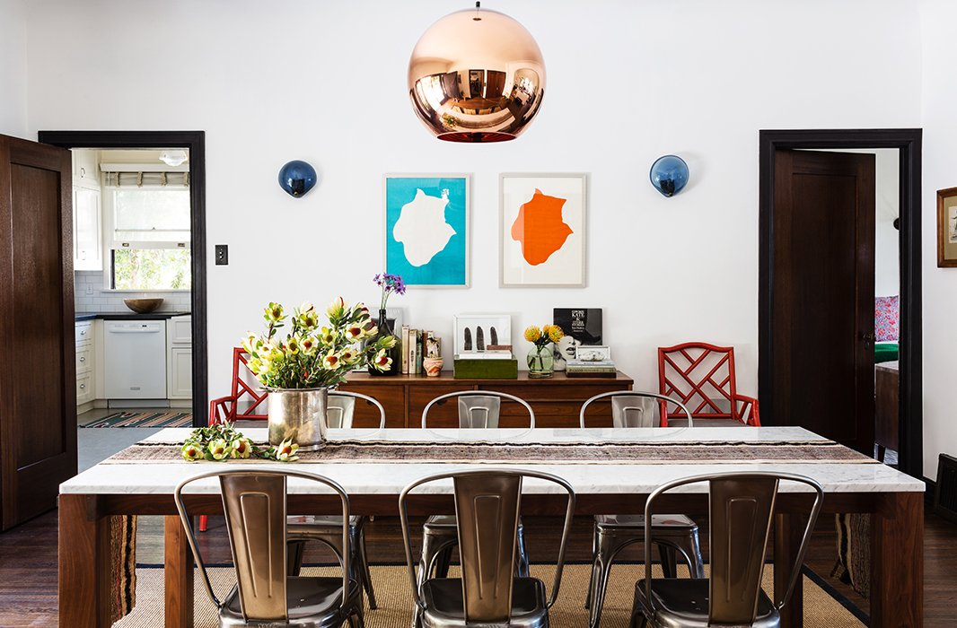 Lizzie designed the dining room around a copper Tom Dixon pendant. Embracing a casual vibe, she picked Tolix chairs and a natural-fiber rug to round out the room.