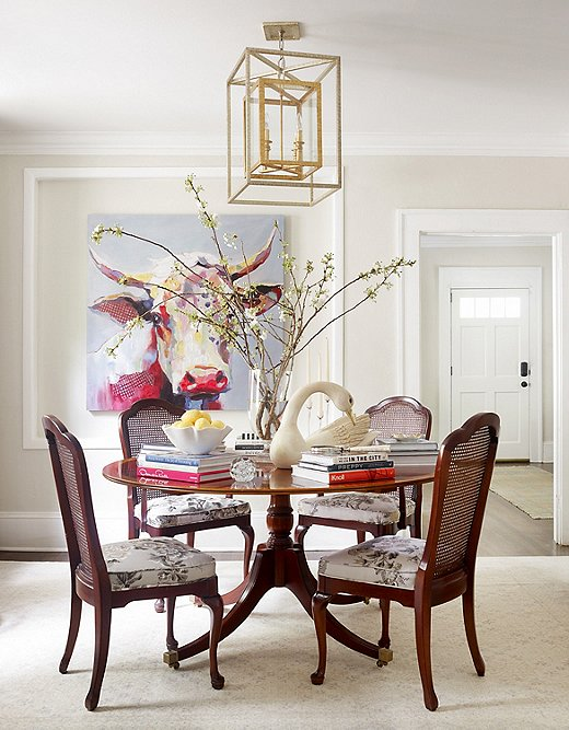Lauren's clients wantedthis painting, which they found at an estate sale, to anchor their main dining area.