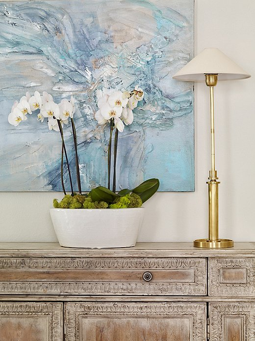 Lauren hung abstract art to add some modern style to the more traditional mix.