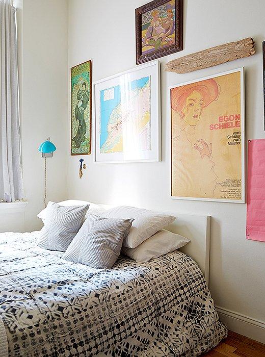 The items displayed above their bed have special meaning to the couple: Marlon found the piece of driftwood during his first trip to Montauk. The framed map of Morocco was one of Lisa's flea market finds and foreshadowed where they would ultimately enjoy their honeymoon.