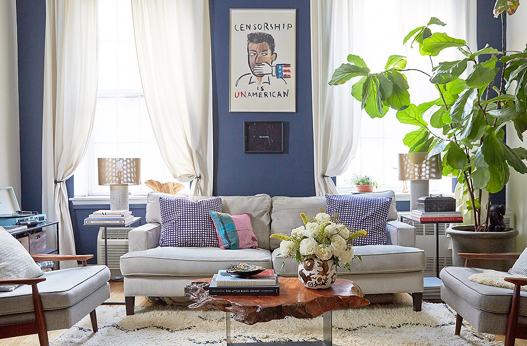 "The painting hanging above the sofa in the living room is a prized find: The couple happened upon someone on the street who was throwing it out. ""We took it home, and it's the centerpiece of our apartment,"" says Lisa."
