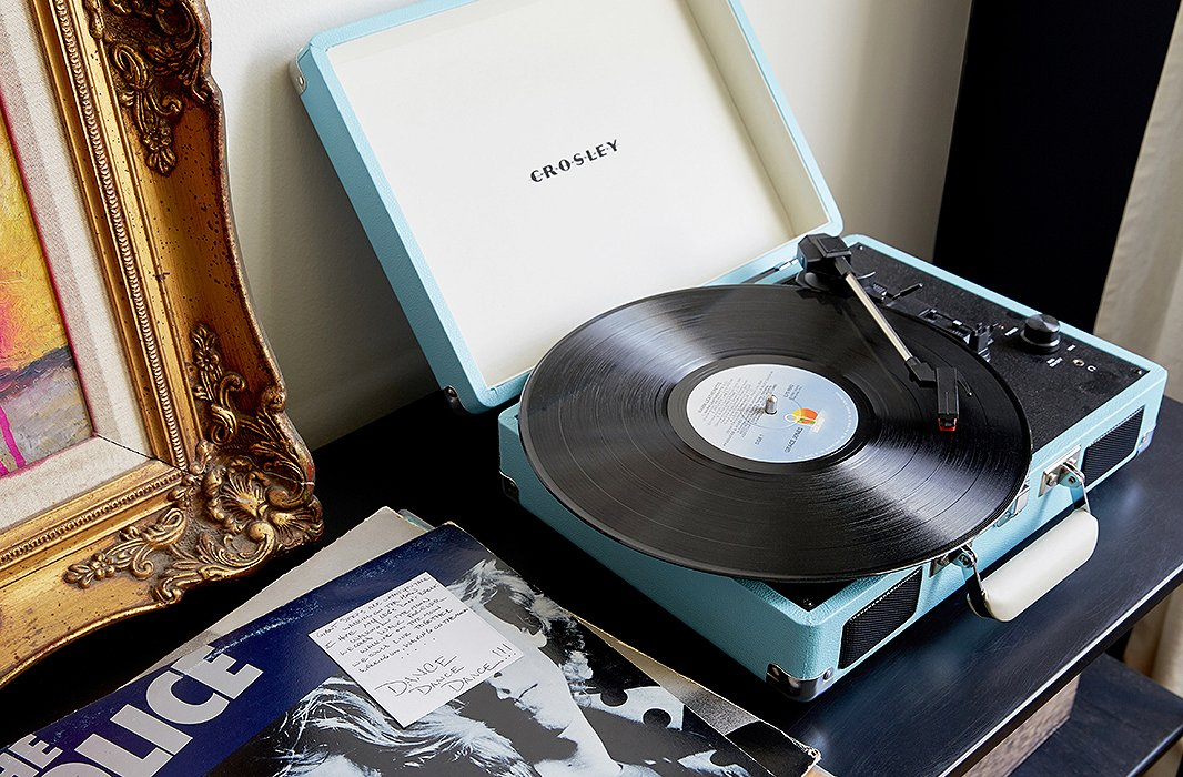 "The records next to their Crosley player were a wedding gift from a friend. ""He chose some of his favorite records and gave them to us, along with little handwritten notes describing what he loved about it or why he thought Marlon or I might like it,"" Lisa says. ""It was such a sweet and sentimental gift."""