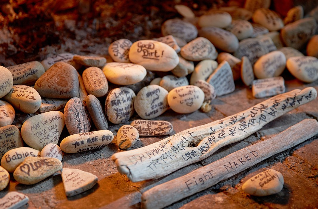Tumbling out of the fireplace are rocks and driftwood from Lisa and Marlon's wedding. Lisa's mother collected them for the nuptials, and guests were invited to write messages and well wishes to the couple.