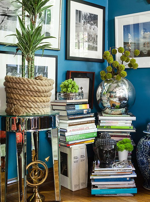 Filling an unused corner of the living room with stacks of books creates an eye-catching display that's easy to move when it comes time to mix up the furniture arrangement.