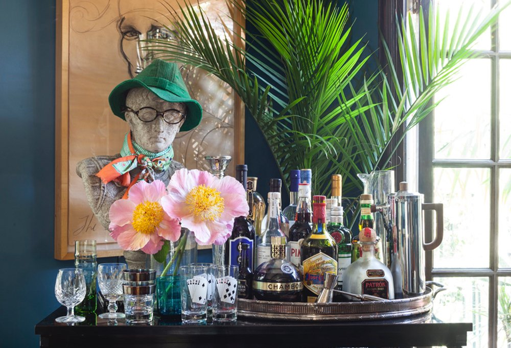 An antique bust, sporting a hat and glasses owned by Powers's late father, adds a bit of gravitas and is a killer conversation starter on her ready-to-serve bar. An oversize tray and mix-and-match glassware transform an otherwise ordinary console table into entertaining central.