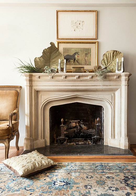 A layered composition gives the mantel an artful elegance.