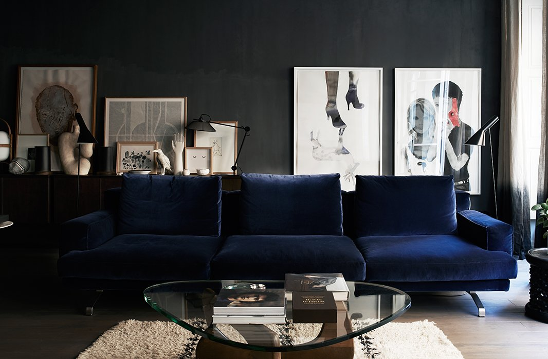 Inside the home of Pierre Emmanuel Martin and Stéphane Garotin, owners of Maison Hand, located in Lyon in the South of France. The blue velvet sofa stands out among a sea of gray and white.