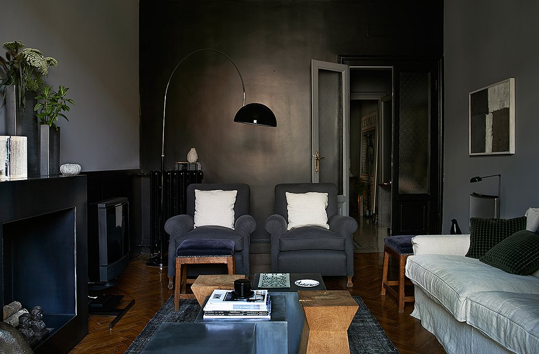 In The Living Room Of A Milanese Architect Single Black Accent Wall
