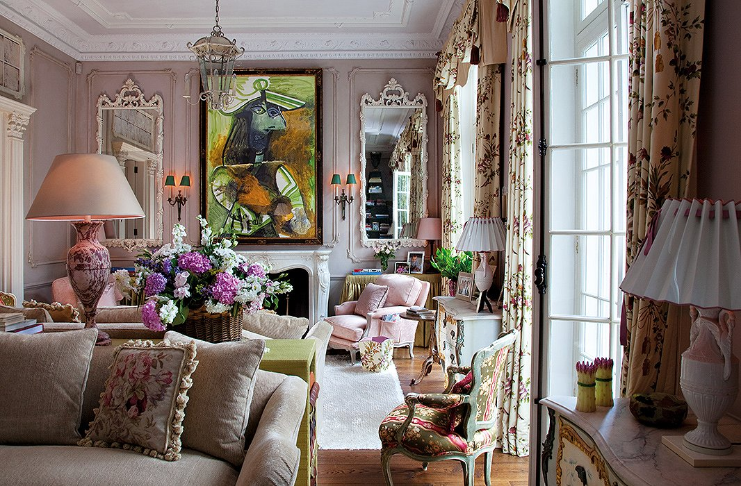 In this drawing room, floral curtains sit comfortably among a collection of artwork by 20th-century masters.
